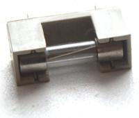 Bezpiecznik topikowy szklany wraz z mocowaniem
