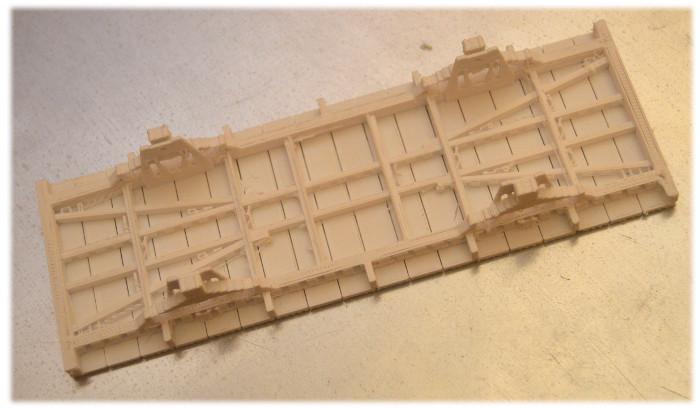 Wydruk z drukarki 3W podwozia wagonu kolejowego, którego model narysowałem w programie OpenSCAD
